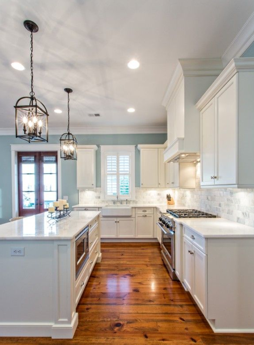 Blue Kitchen Paint Colors. Raindrop blue kitchen with white cabinets and lantern chandeliers Our 10 Favorite Kitchen Paint Colors by Sherwin Williams